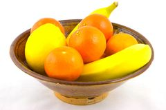 Bowl of Fruit. A bowl of fruit containing oranges, bananas and a lemon stock image