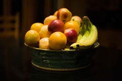 Bowl of Fruit. With Apples, Bananas and Oranges on a Table Stock Image