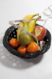 Bowl of Fruit an Apple with Heart Cut Out Royalty Free Stock Photography