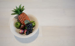 Bowl of fruit. A bowl of artificial fruit for display purposes Stock Images