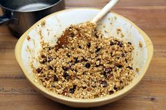 Bowl of fruit flapjack mix, ready to go into the oven.  Royalty Free Stock Photo