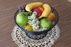 Bowl of fruit on lace Royalty Free Stock Photography