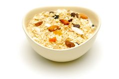 Bowl of fruit and nut muesli isolated Royalty Free Stock Images