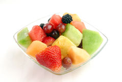 Bowl of fruit salad. A bowl of fruit salad on a white placemat Royalty Free Stock Image