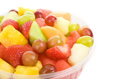 Bowl of Fruit Salad. Bowl of delicious, healthy fruit salad isolated on white Royalty Free Stock Photos