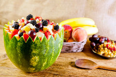 Bowl of fruit salad. Focus in the middle of the fruit salad Stock Image