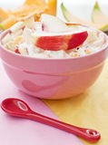 Bowl of fruit salad with red spoon Stock Photo
