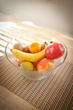Bowl of fruit on table Royalty Free Stock Photos