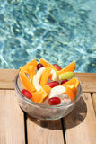 Bowl of fruite. The bowl with fruits near swimming pool Stock Photo