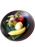 Bowl of fruits. Fruits on banana leaf in a bowl Stock Photography