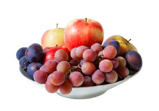 Bowl with fruits isolated on white background Royalty Free Stock Image