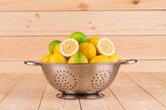 Bowl with fruits, on wooden table Royalty Free Stock Photography