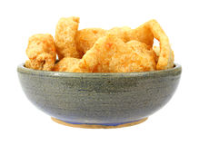 Bowl full of barbeque seasoned pork rinds royalty free stock image
