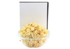 Bowl full of caramel popcorn, DVD cover. Bowl full of caramel popcorn with blank DVD cover. Isoalted royalty free stock images