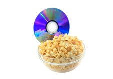Bowl full of caramel popcorn with DVD disk . Stock Image