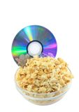 Bowl full of caramel popcorn with DVD disk . Stock Photos
