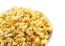 Bowl full of caramel popcorn. Isolated. Bowl fragment, full of caramel popcorn isolated on white background royalty free stock image