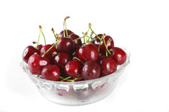 Bowl full of cherries. Bowl full of fresh cherries on white background stock photos