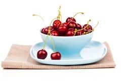 Bowl full of cherries Stock Images