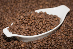 A bowl full of coffee beans Stock Images