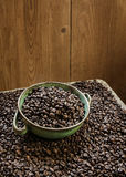 Bowl full of coffee grains Royalty Free Stock Photo