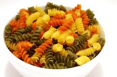 Bowl full of Colorful Pasta Stock Images