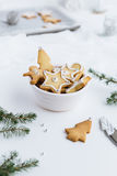 Bowl Full of Festive Christmas Biscuits Decorated with White Icing and Silver Sugar Balls Royalty Free Stock Photos