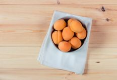Bowl full of fresh apricots. Top view. Stock Images