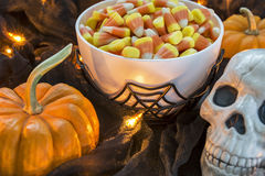 A bowl full of Halloween candy corn in a spooky setting. A bowl full of traditional Halloween candy corn in a dimly lit spooky setting royalty free stock photos
