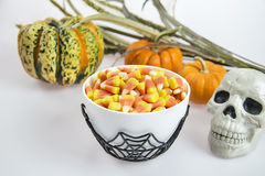 A bowl full of Halloween candy corn on a white background Royalty Free Stock Photography
