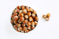 Bowl full of hazelnuts. Isolated bowl full of hazelnuts on white background stock photos
