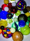 Bowl full of marbles and balls Royalty Free Stock Photography