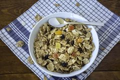 A bowl full of muesli cereals with spoon Royalty Free Stock Images