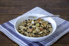 A bowl full of muesli cereals with spoon Royalty Free Stock Image