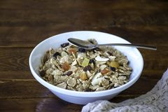 A bowl full of muesli cereals with spoon Stock Image