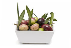 A bowl full of olives. Stock Photos