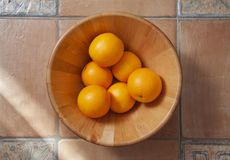 A bowl full of oranges stock photo
