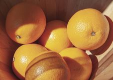 A bowl full of oranges stock image