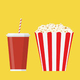Bowl full of popcorn and glass of drink. Royalty Free Stock Images