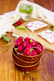 Bowl full of Radishes on the wooden background. (selective focus Royalty Free Stock Photography