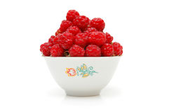Bowl full of raspberries. Isolated on white Royalty Free Stock Images