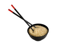 Bowl full of rice and chopsticks Royalty Free Stock Photo