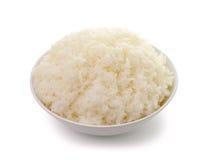 Bowl full of rice on white Stock Photos