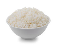 Bowl full of rice on white background Royalty Free Stock Images