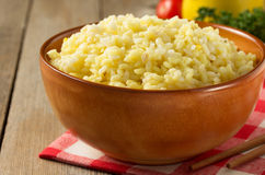 Bowl full of rice on wood Royalty Free Stock Photo