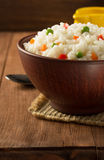 Bowl full of rice on wood Stock Image