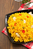 Bowl full of rice on wood Stock Images