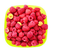Bowl full of ripe raspberries isolated on white background. Bowl full of ripe raspberries isolated on white background, top view Royalty Free Stock Images