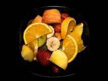 Bowl full of tropical fruits stock image
