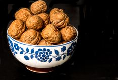 A bowl full with walnuts Stock Image